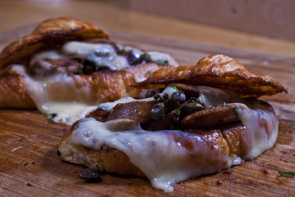 Butter Croissants stuffed with sausage and capers