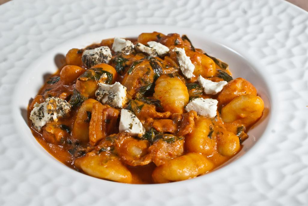 Gnocchi with Bacon, Spinach, Vidalia Onion and Herbed Goat Cheese in Rosé Sauce