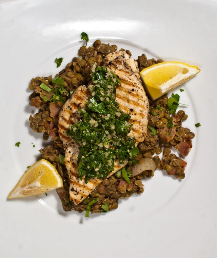 Grilled Chicken Paillard with Gremolata on Warm Lentil Salad with Bacon and Herbs