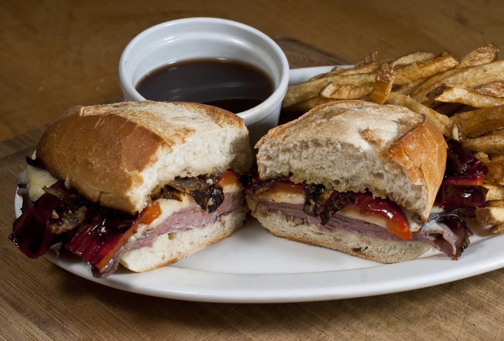 Hot Roast Beef Sandwich with Roasted Red Peppers, Sauteed Onions, Swiss Cheese, Garlic Aioli, and Au Jus for dippin'