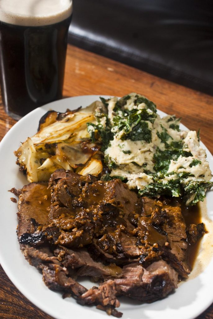 Guinness braised brisket au jus, sautéed cabbage and colcannon