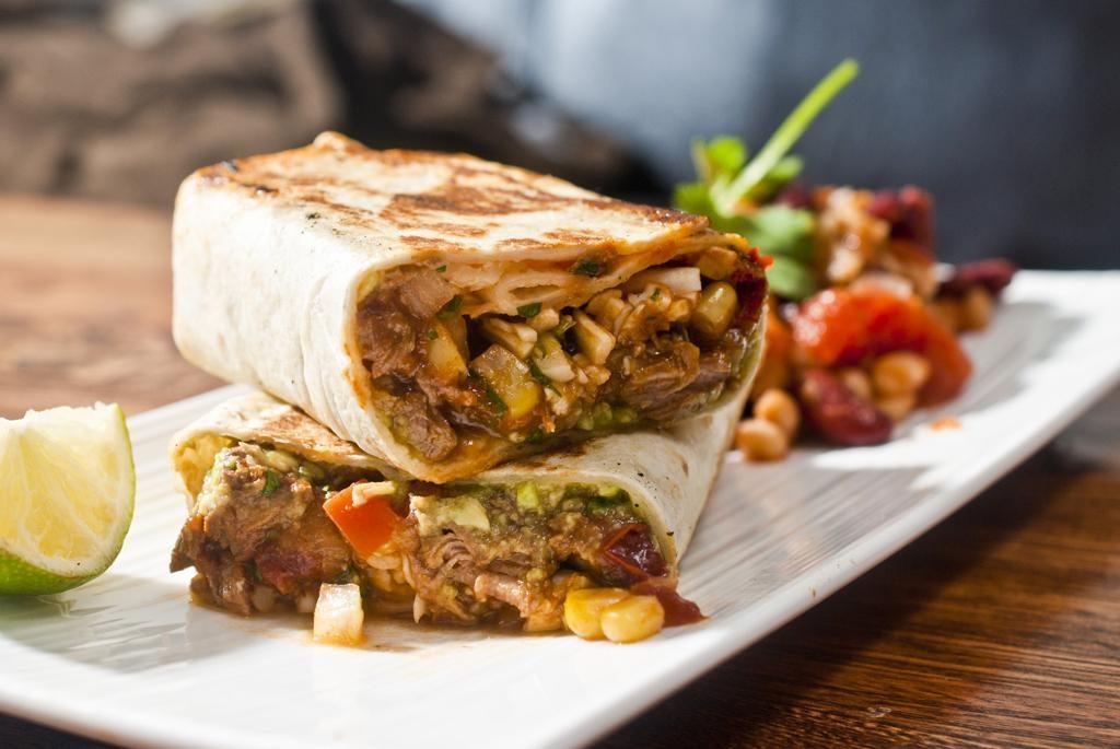 Braised Beef Burrito With homemade guacamole and pico de gallo