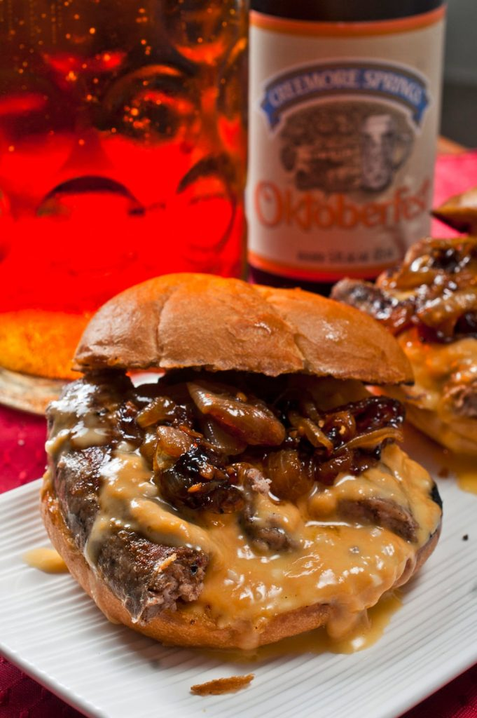 Bratwurst Sandwich with Beer Braised Onions and Beer Cheese Sauce | Oktoberfest Recipes To Keep The Party Going | Homemade Recipe