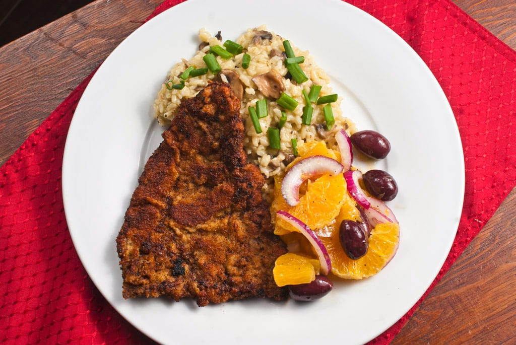Cotoletta with mushroom risotto and orange salad