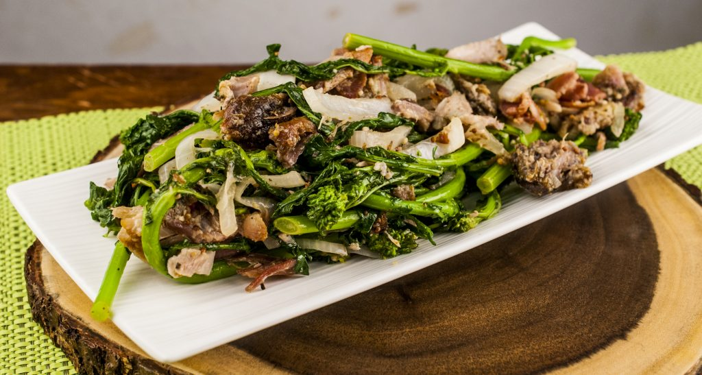Warm Rapini Salad with bacon and porchetta in a dijon balsamic dressing