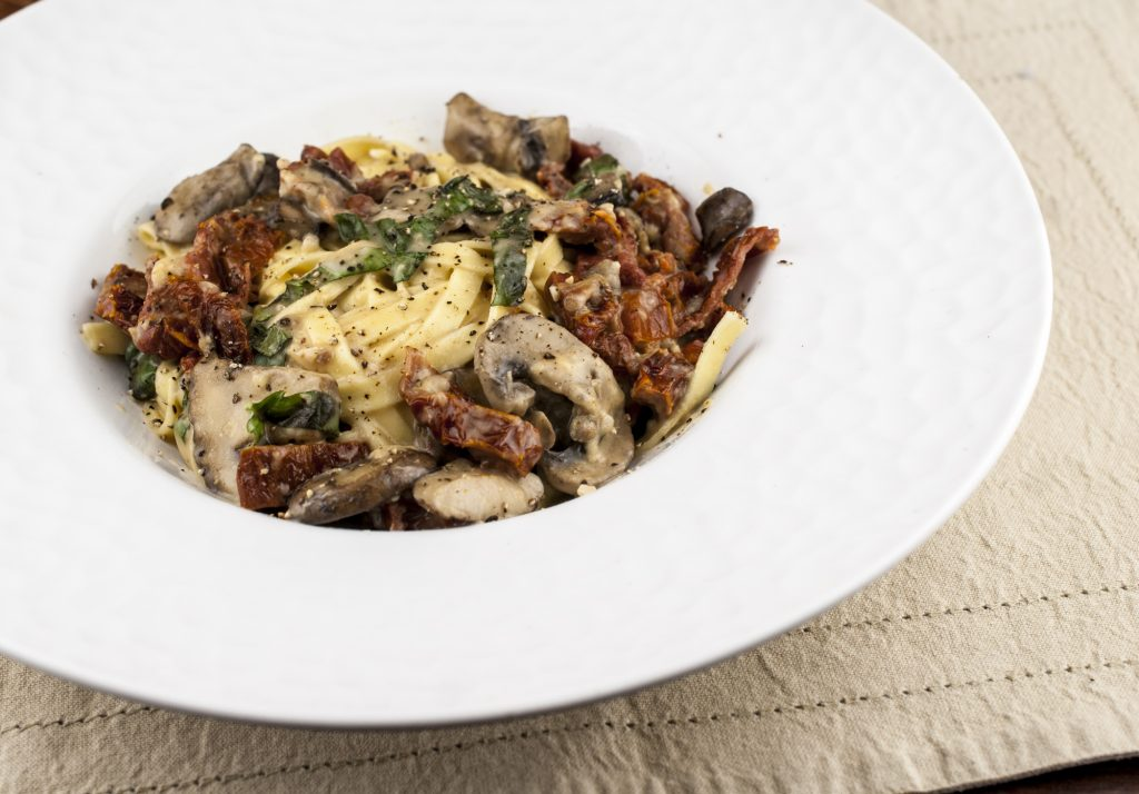 Fettuccine with mushrooms and sun dried tomatoes in cream sauce
