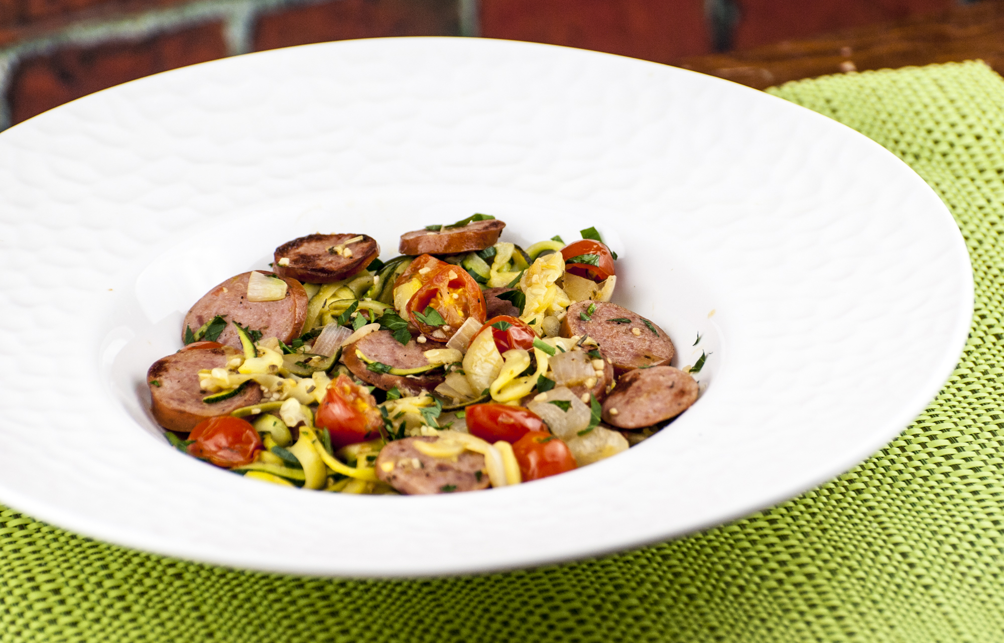 Zucchini Noodles with Smoked Sausage and Cherry Tomatoes in a Zesty Pan Sauce
