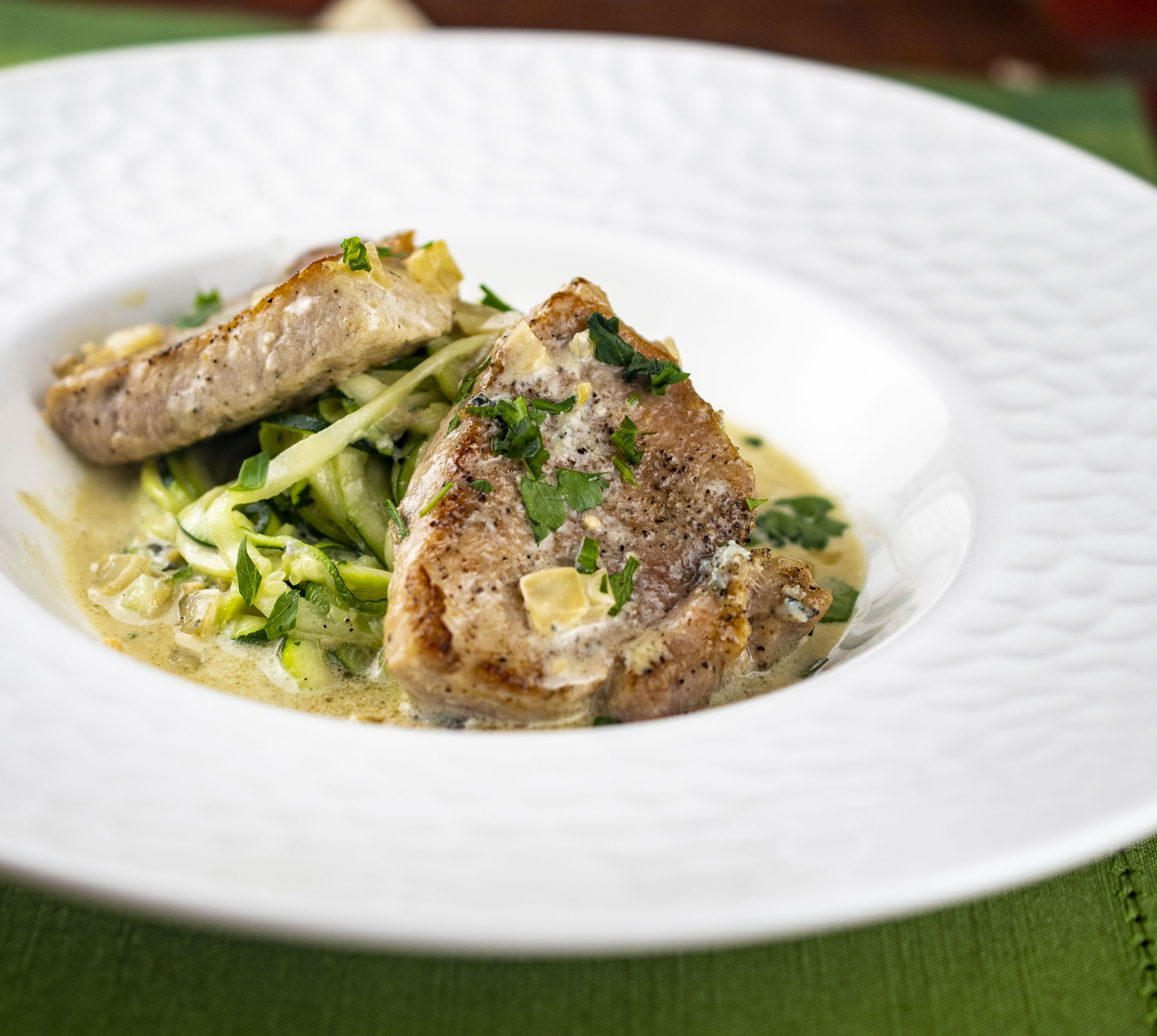 Pork medallions in blue cheese sauce served over spiralized zucchini